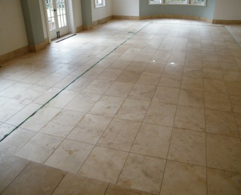 Limestone pool room after cleaning and honing