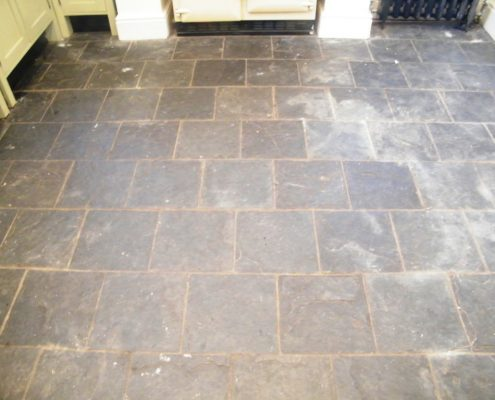Slate kitchen floor before cleaning