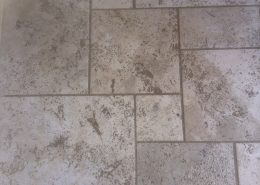 Travetine kitchen floor before cleaning and sealing