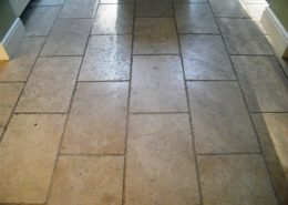 Travertine kitchen floor before cleaning