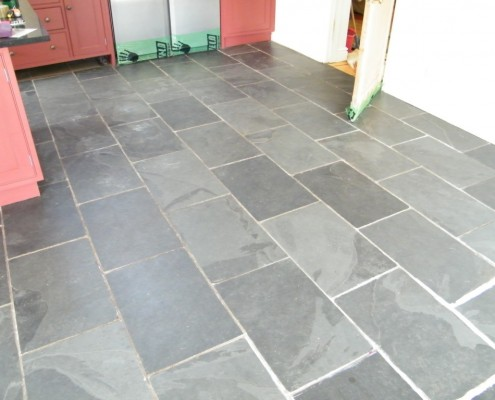 Slate floor before being cleaned