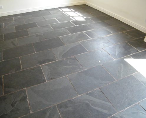Slate floor before cleaning