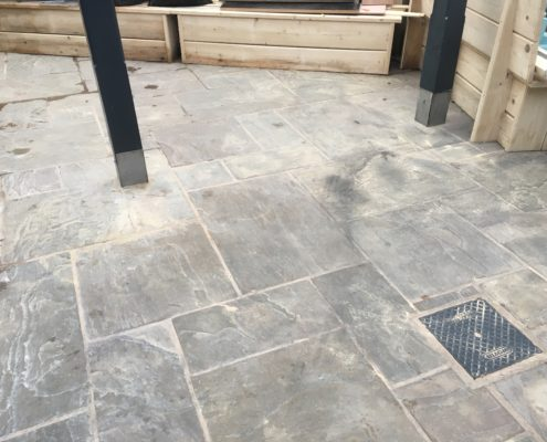Deep clean and seal of Indian Stone external eating area of public house in Congleton, Cheshire before