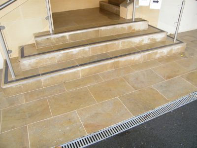External sandstone stairs after 1