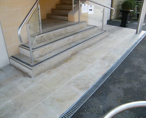 External sandstone stairs after 2
