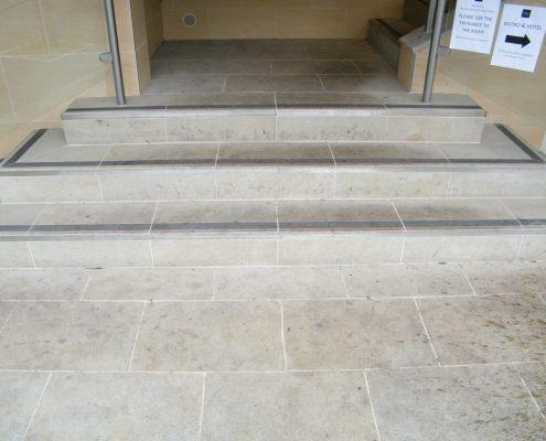 External sandstone stairs before