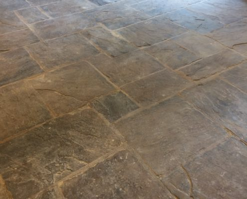 Yorkstone Flagstone floor in Glossop High Peak Derbyshire before cleaning