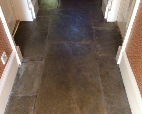 Yorkstone Flagstone hall floor in Matlock Derbyshire before cleaning