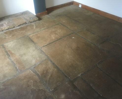Yorkstone floor cleaning in Hayfield, High Peak, Derbyshire before cleaning